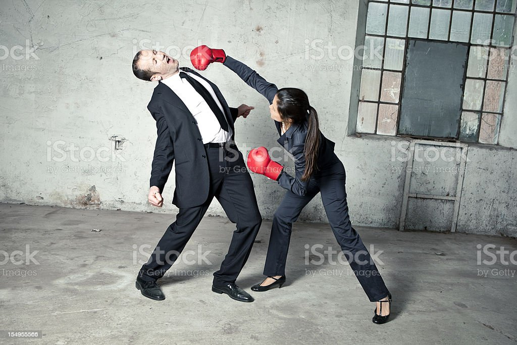 Woman is boxing a businessman royalty-free stock photo