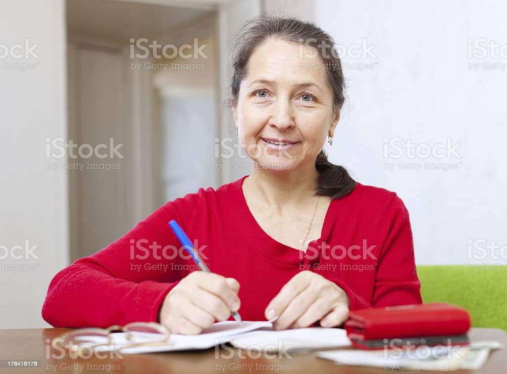 woman is calculated the family budget royalty-free stock photo