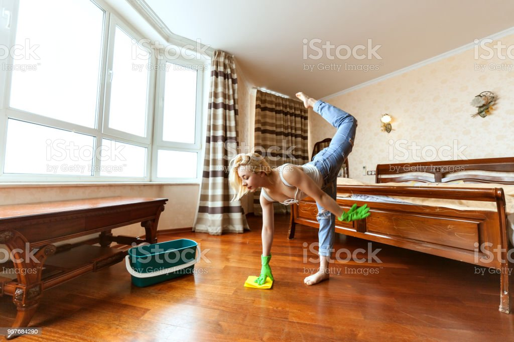 Woman is cleaning in an apartment. stock photo