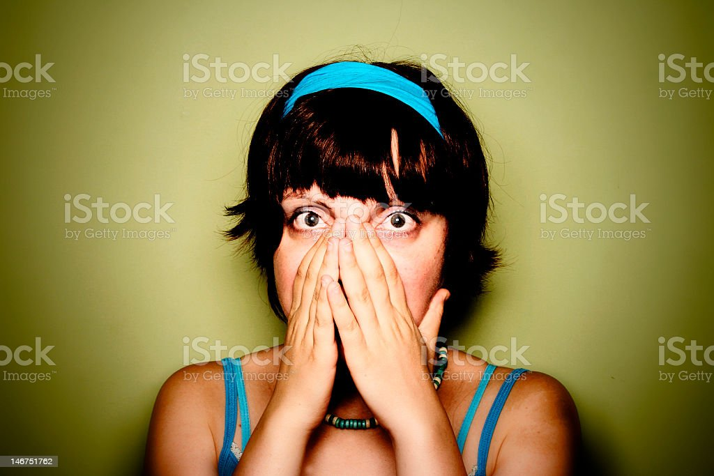 A woman is covering her mouth to stop sneezing stock photo