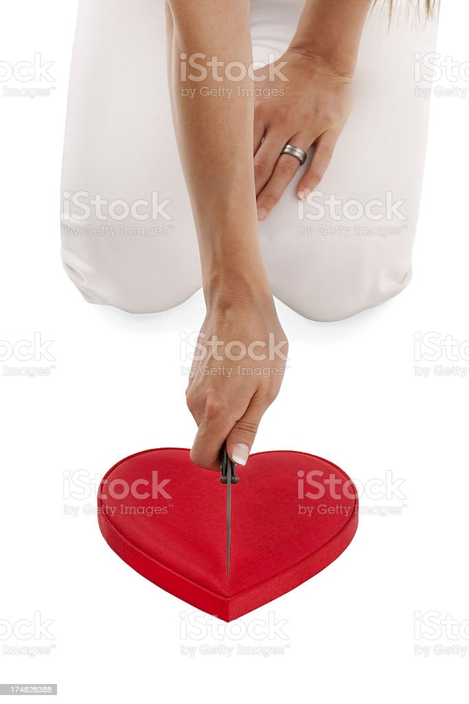 Woman is Cutting hearth shape with knife royalty-free stock photo