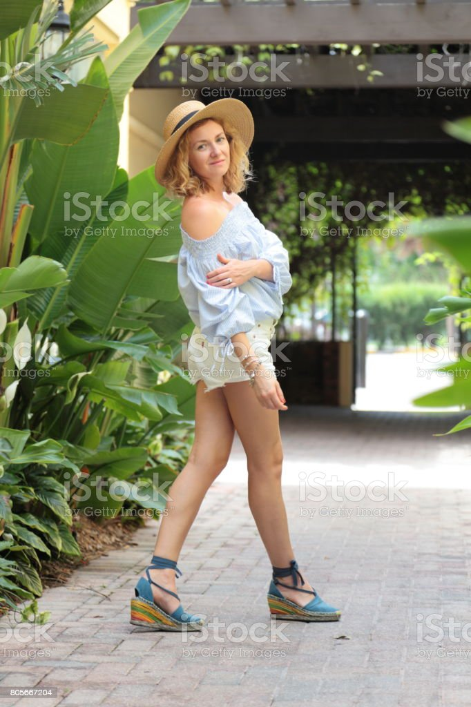 Woman is dancing on the tropical street. stock photo