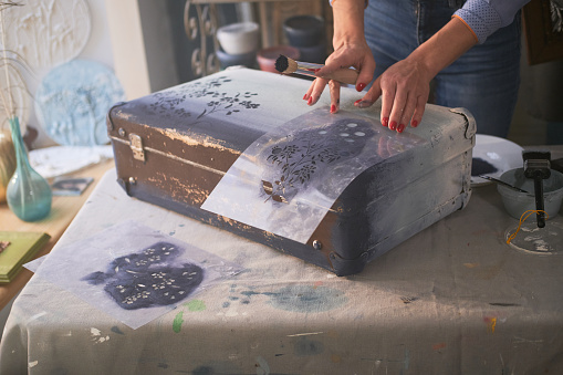 istock Woman is decorating old vintage case 1210369610