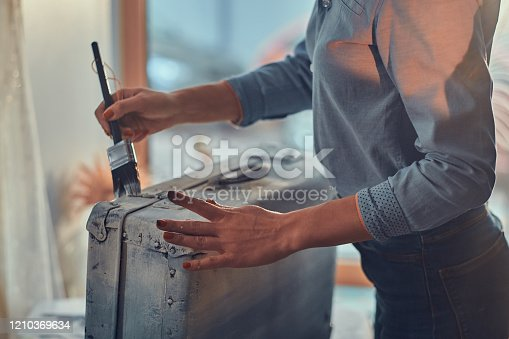 istock Woman is decorating old vintage case 1210369634