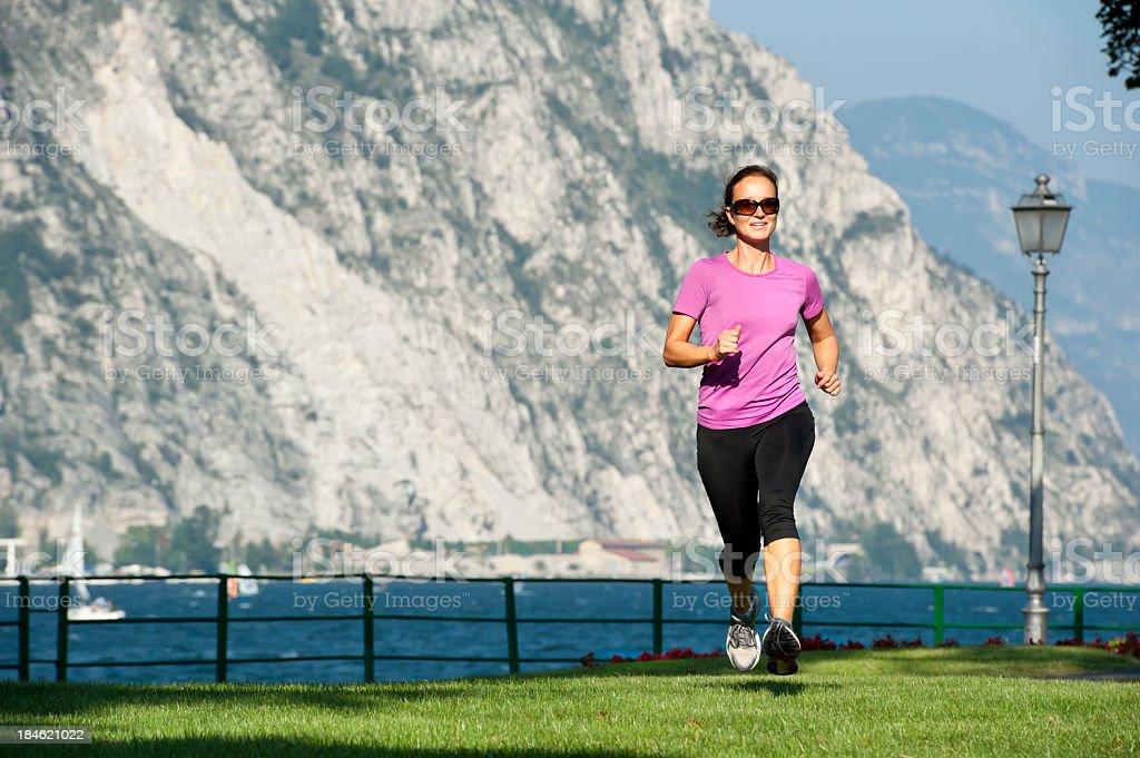 Woman is doing an early morning cross country run royalty-free stock photo