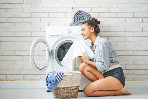 woman is doing laundry stock photo