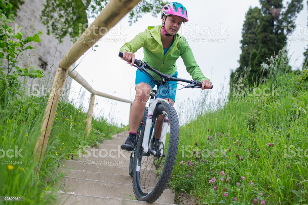 Woman is driving down the stairs stock photo
