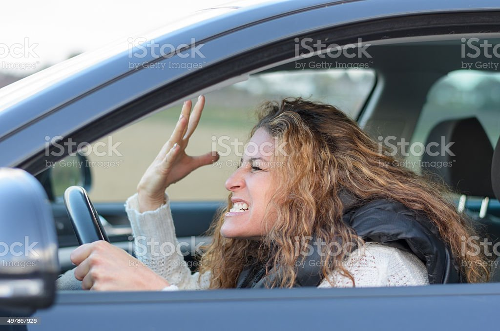 woman is driving her car stock photo