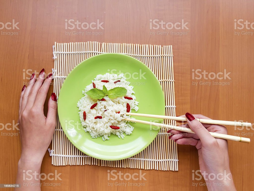 Woman is eating an asian dish royalty-free stock photo