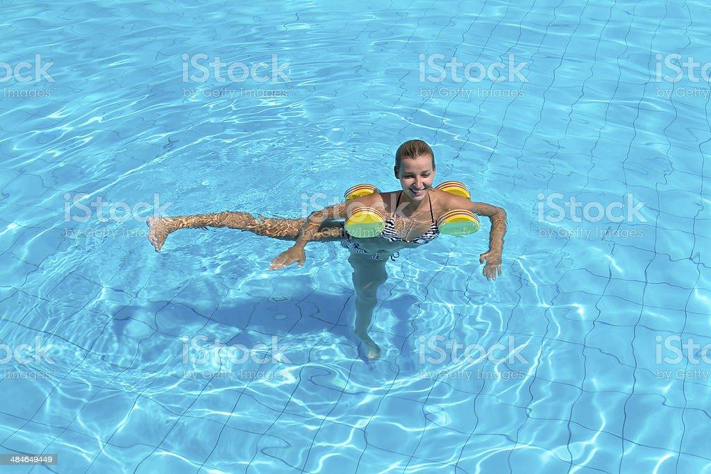 Woman is engaged aqua aerobics in water stock photo