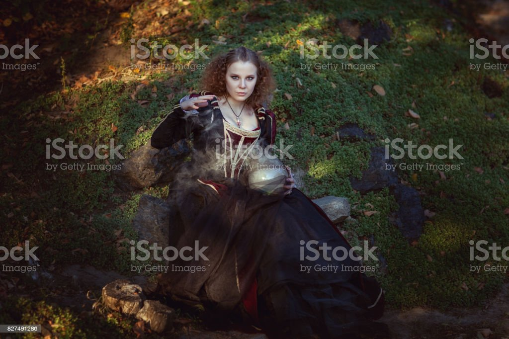 Woman is engaged in magic. stock photo