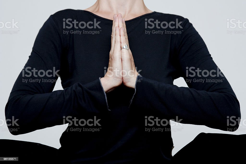 Woman is engaged in yoga royalty-free stock photo
