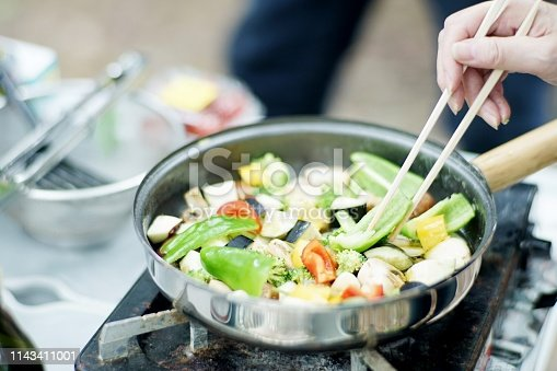 Woman is frying vegetables,Japan