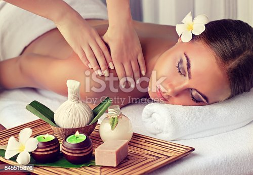 istock Woman is getting massage in the spa salon. 845515876