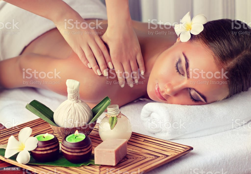 Woman is getting massage in the spa salon. stock photo