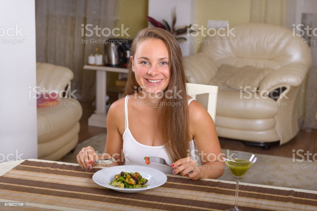 Woman is having delicious dinner easy healthy salad stock photo