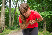 istock Woman is having heart attack during running activity 825092882