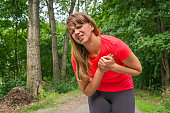 istock Woman is having heart attack during running activity 825096286