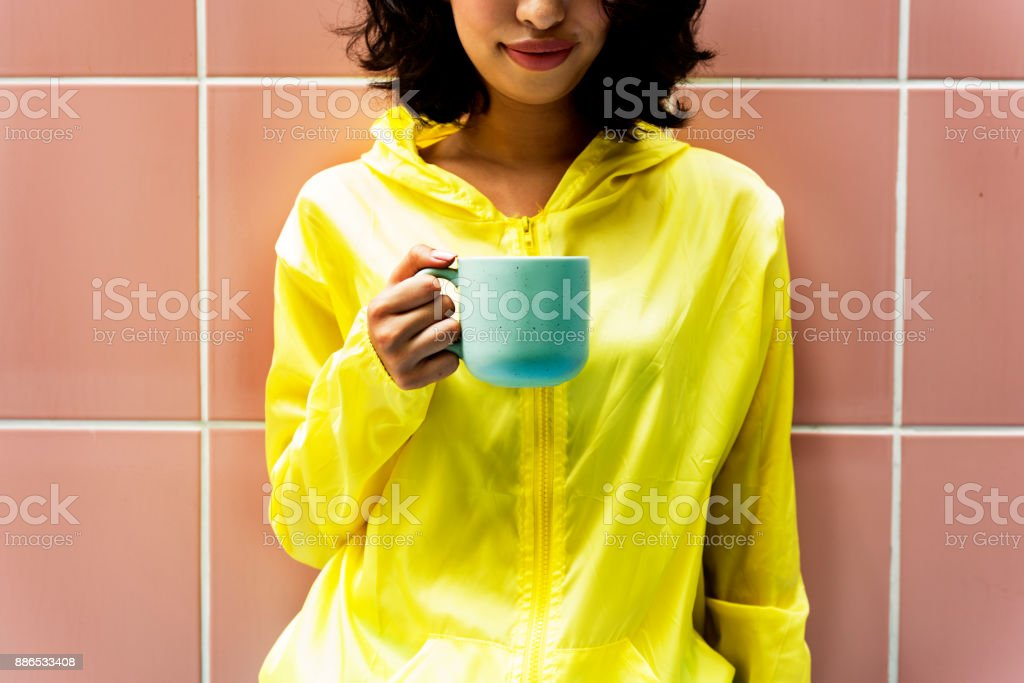 Woman is holding a coffee cup stock photo
