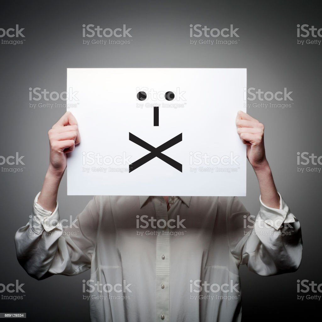 Woman is holding white paper with smile. Lips Sealed and silence concept. stock photo