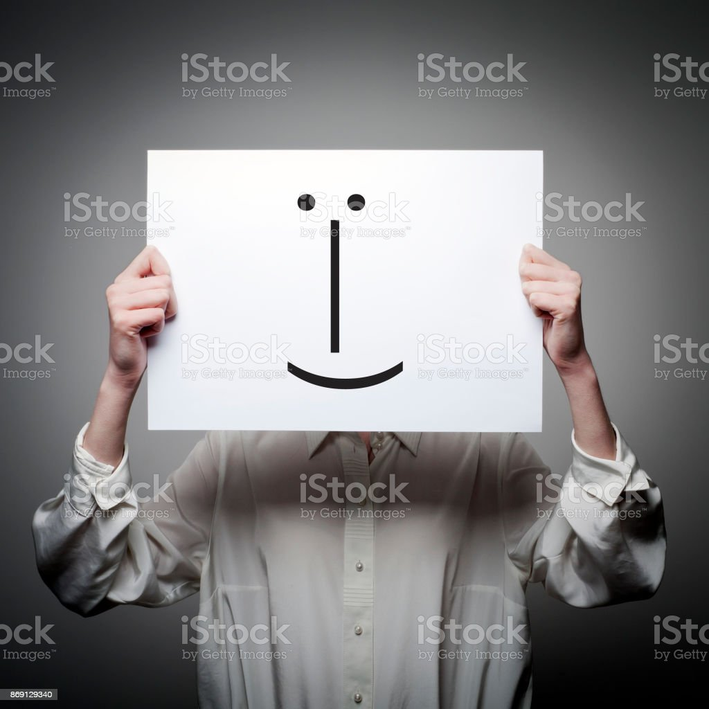 Woman is holding white paper with smile. Long nose and Liar concept. stock photo