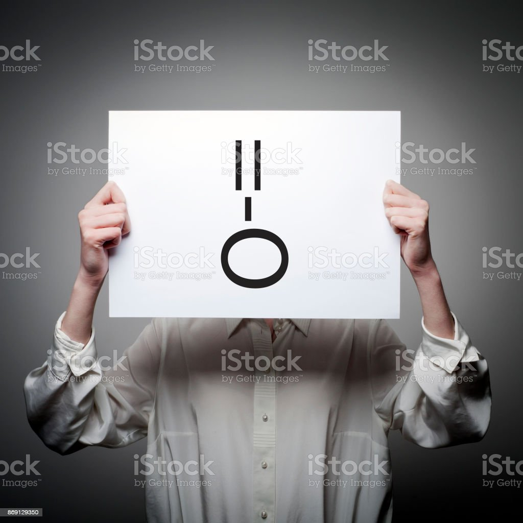 Woman is holding white paper with smile. Surprise and amazement concept. stock photo