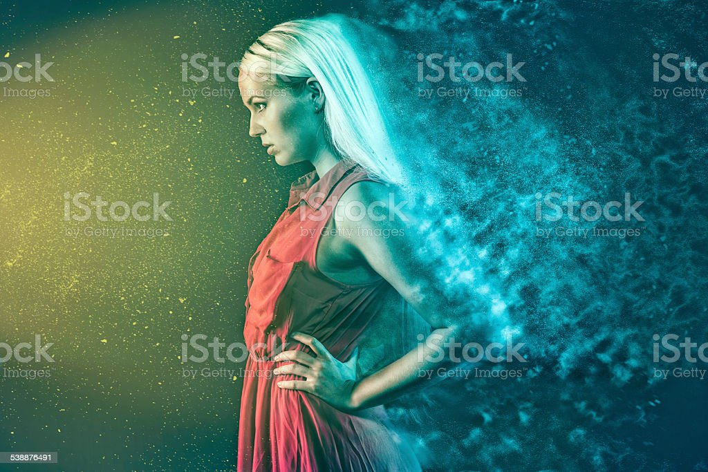 Woman is hypnotized by supernatural light stock photo