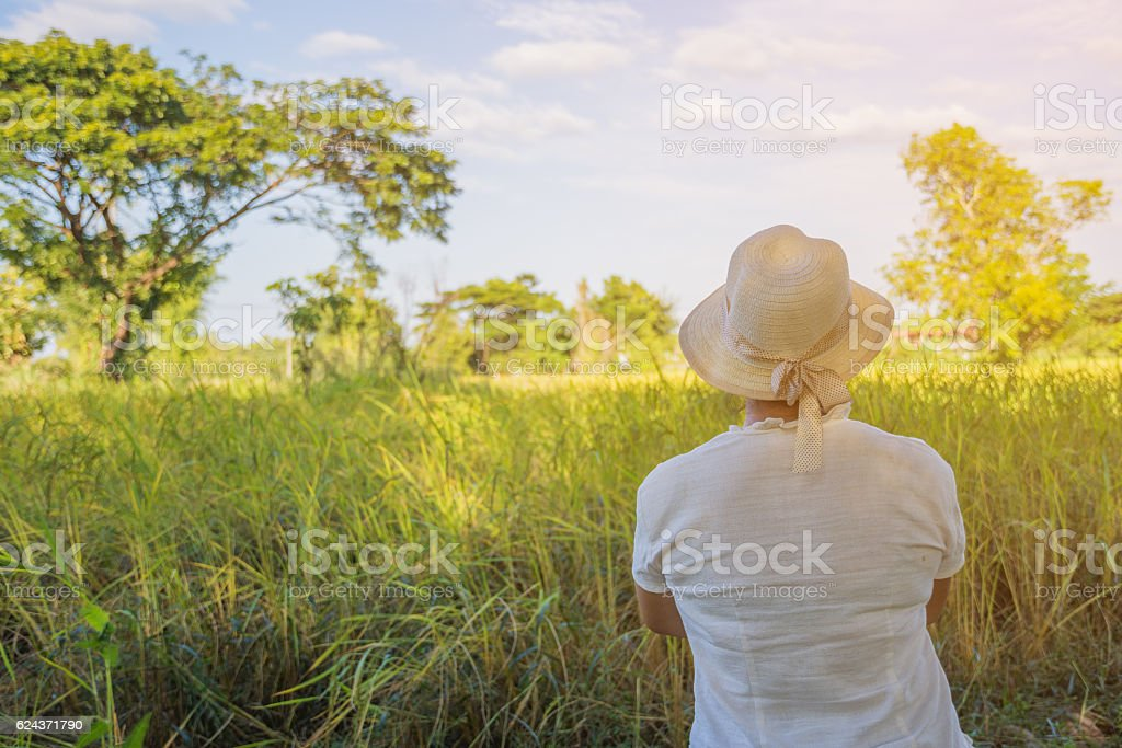 woman is looking her farm. stock photo
