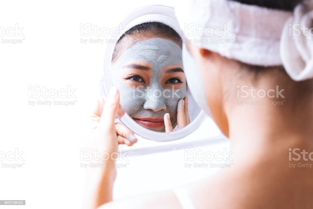 A woman is marking a face. stock photo