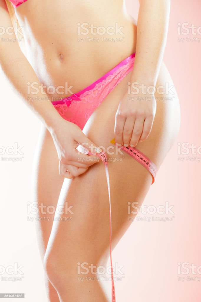 woman is measuring her thigh royalty-free stock photo