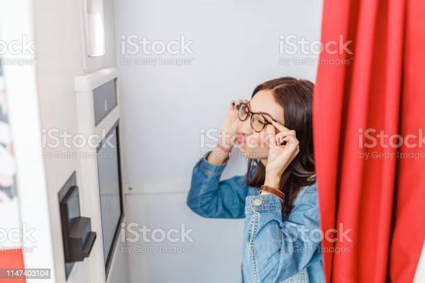 Woman is photographed and amused in a photo booth making istant for picture id1147403104?b=1&k=6&m=1147403104&s=612x612&h=j4e1s6pzwoa4e8eub2b5zla 13rihq49hawl i90jli=