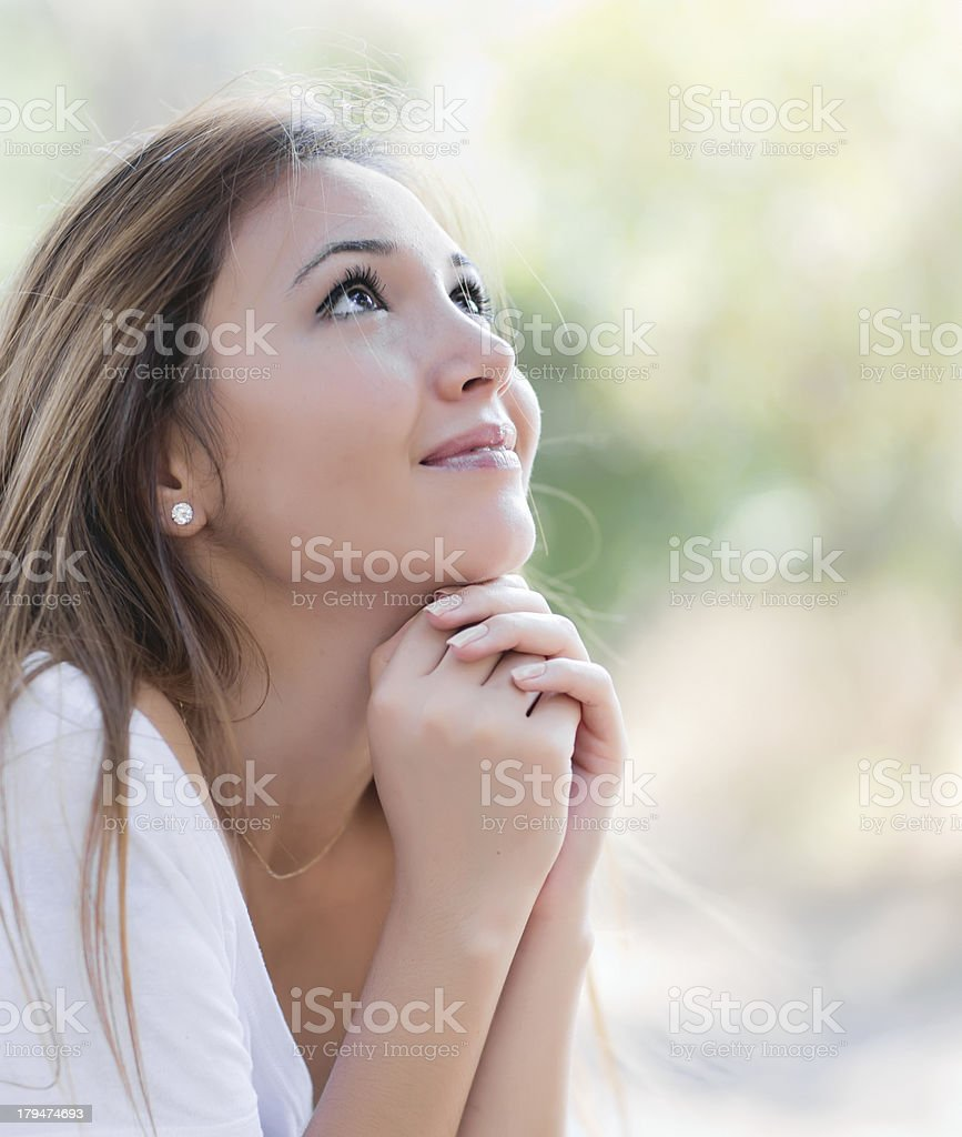 woman is praying to God stock photo