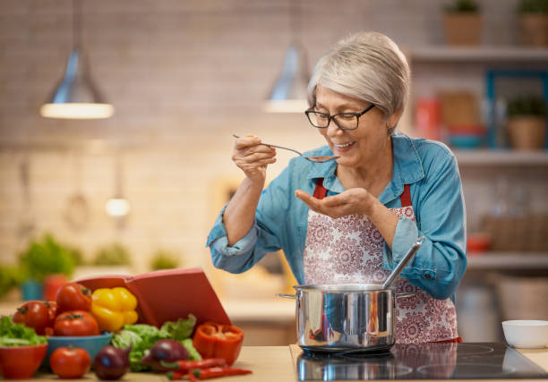 woman is preparing vegetables stock photo