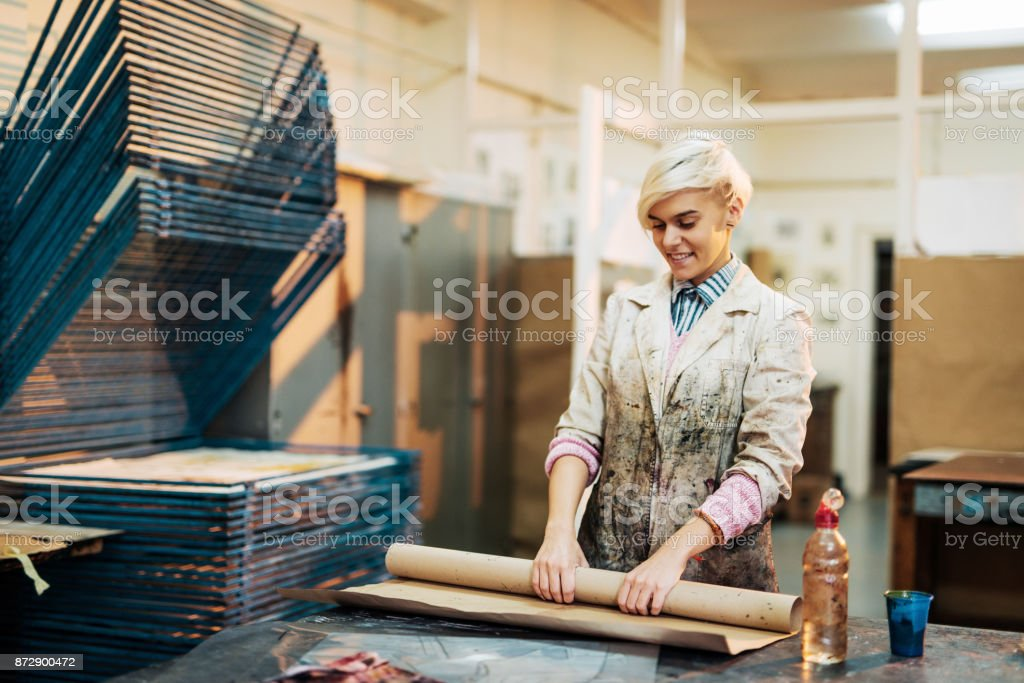 Woman is preparing workshop for new intaglio printing project stock photo