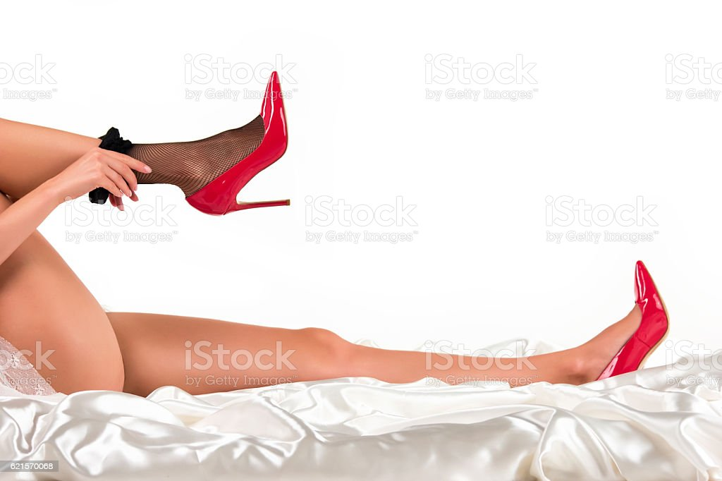Woman is putting on stockings. photo libre de droits