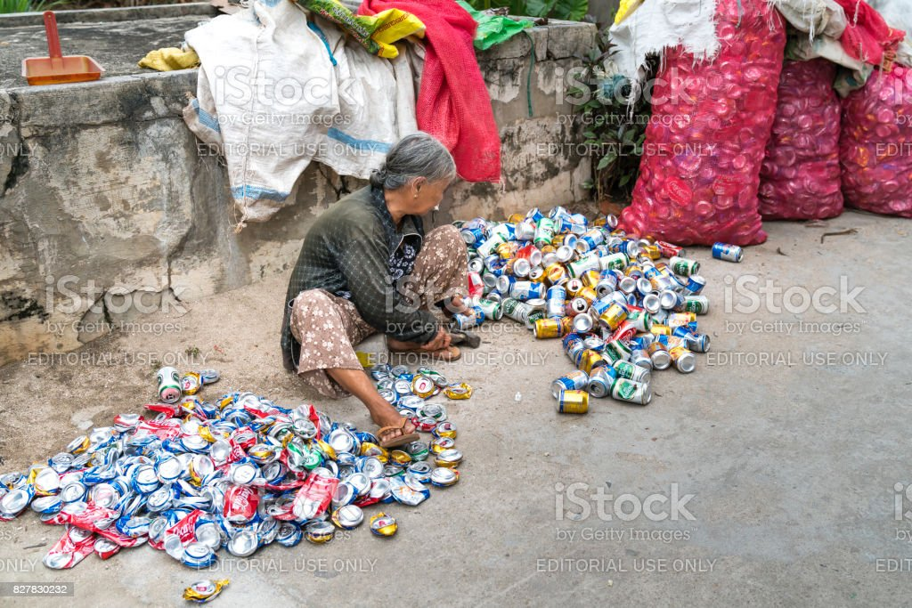 woman is recycling rubbish in a small village stock photo