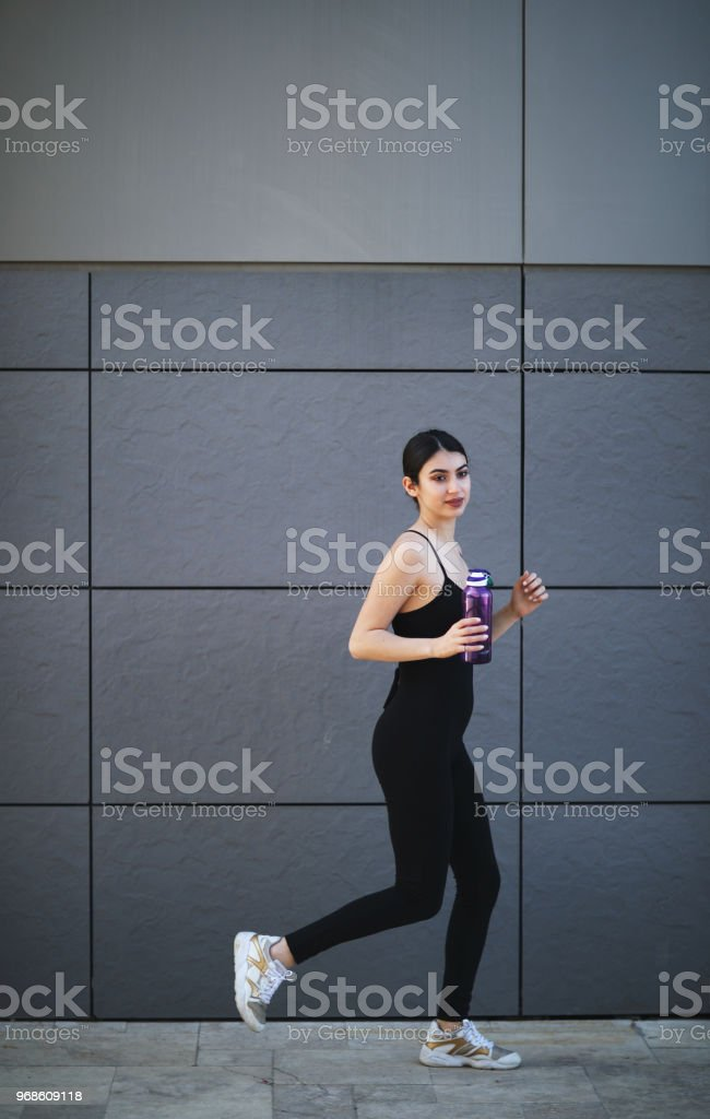 Woman is runing stock photo