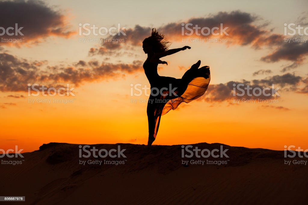 Woman is running at sunset. stock photo