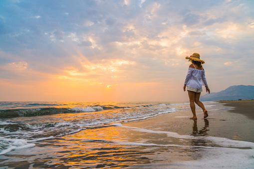 istock Woman is running to the sea 837492908