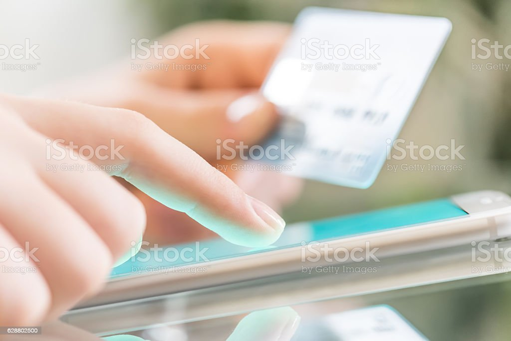Woman is shopping online using a smartphone. stock photo