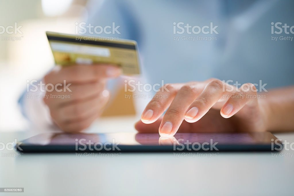 Woman is shopping online with digital tablet stock photo