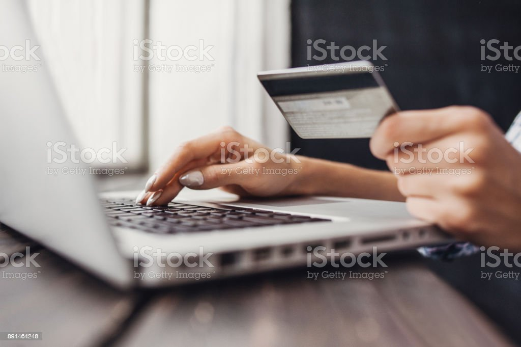 Woman is shopping online with laptop computer and credit card stock photo