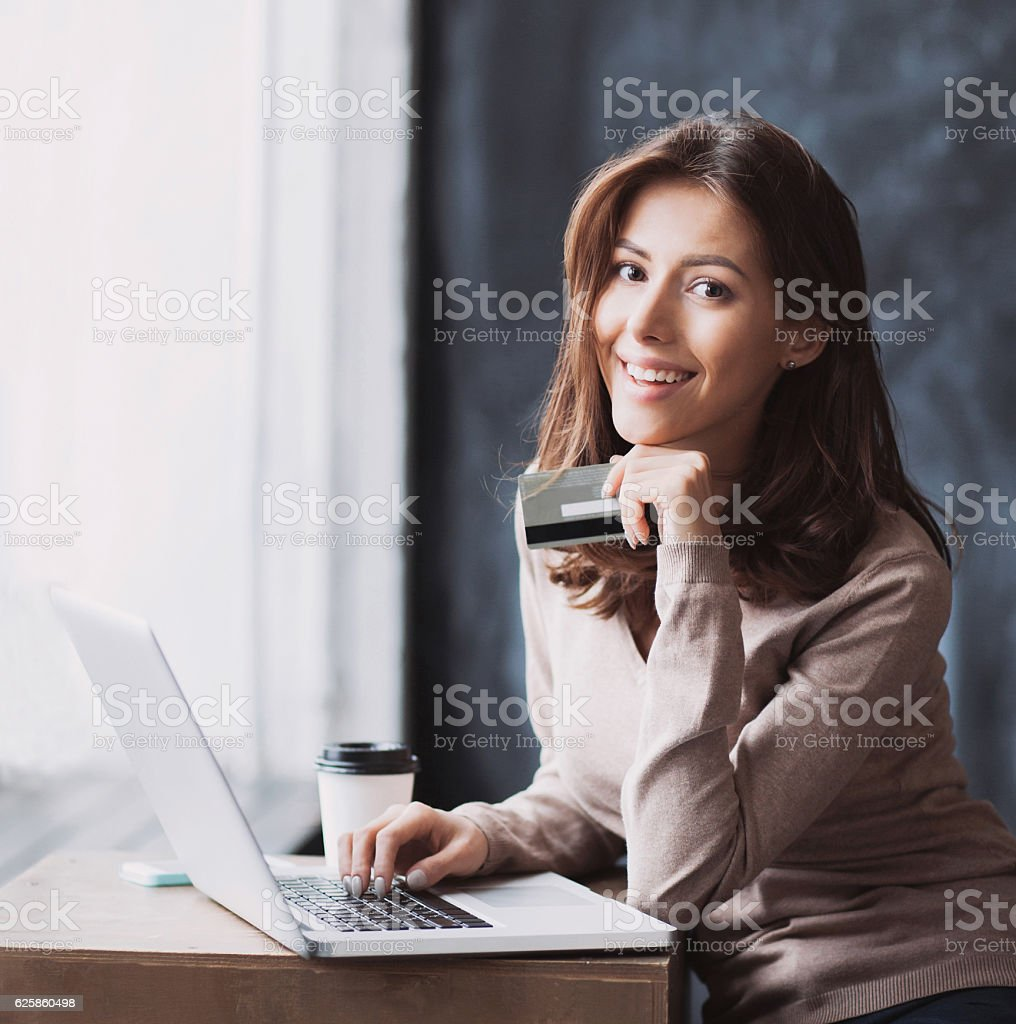 Woman is shopping online with laptop stock photo