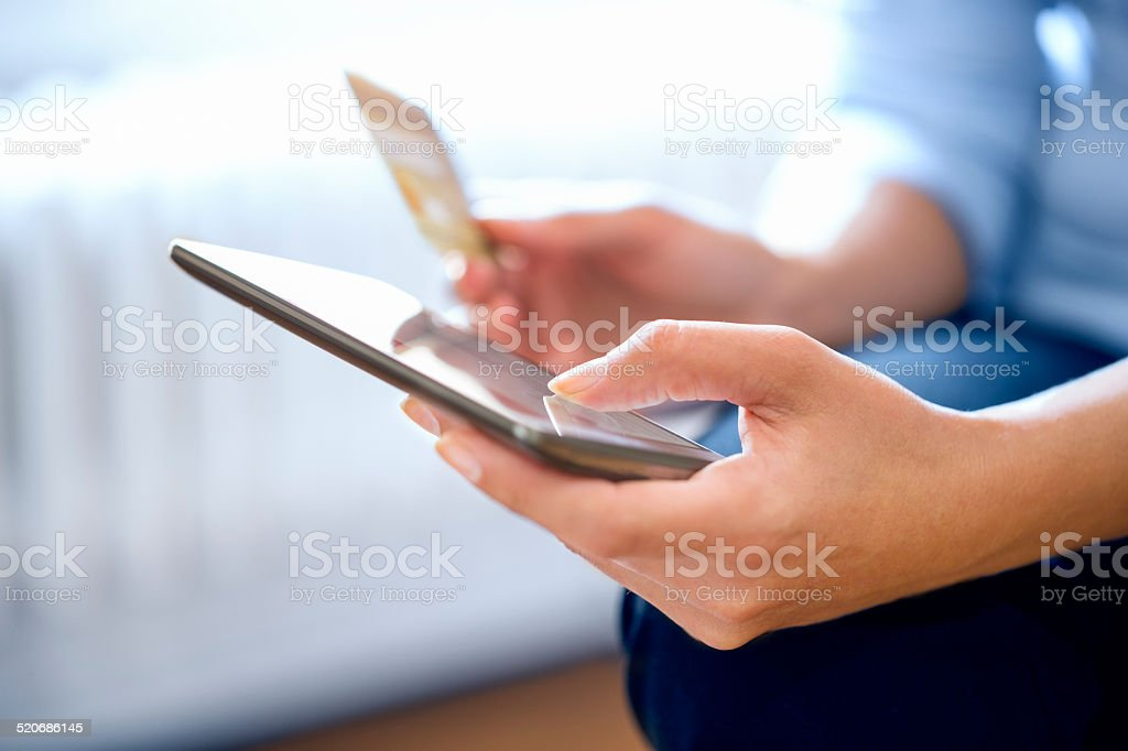Woman is shopping online with smartphone stock photo
