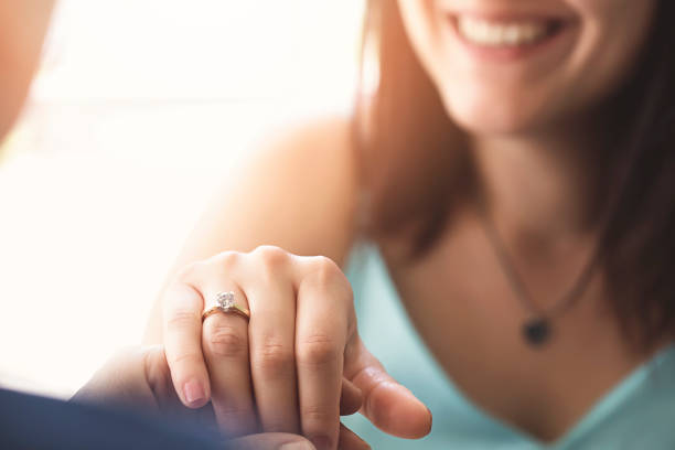 woman is showing her diamond ring to her mum - diamond ring hand stock photos and pictures