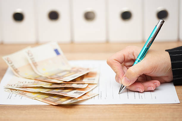 woman is signing contract to get a lot of money woman is signing contract to get a lot of money borrowing stock pictures, royalty-free photos & images