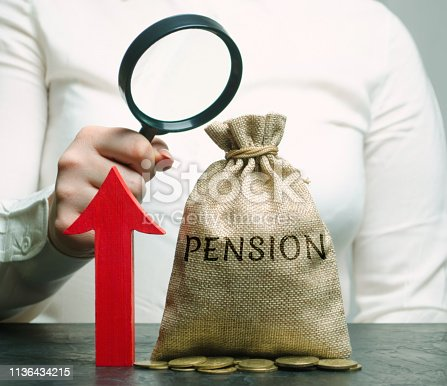 istock A woman is studying the growth of pension payments. Accumulation of pension contributions. Improving the financial condition of older people. Surcharge and pension supplements. Loan portfolio growth. 1136434215
