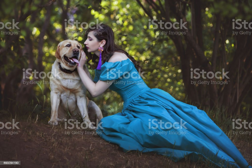 Woman is talking to a big dog. stock photo
