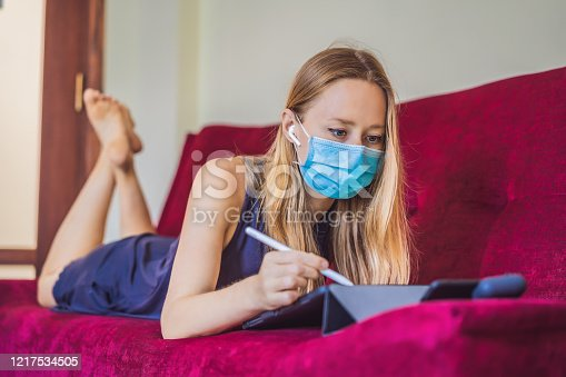 1134879628 istock photo Woman is teaching drawing on a tablet at home in quarantine. Coronovirus, self-isolation 1217534505