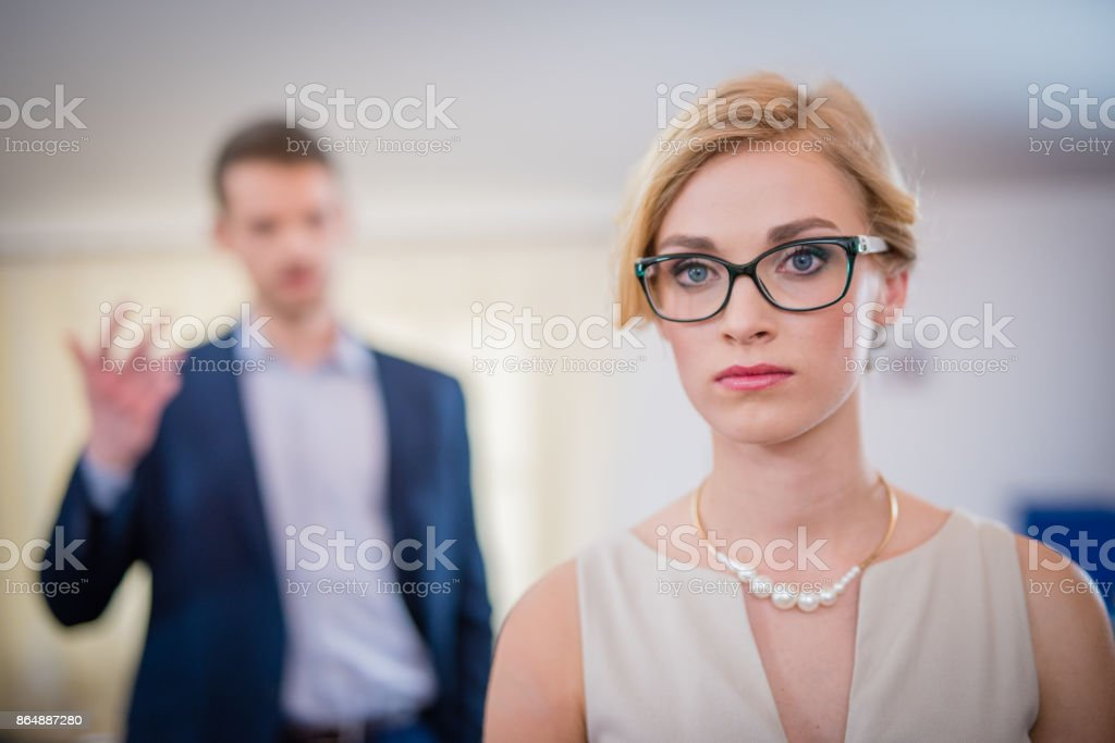 Woman is tired of listening to her boss stock photo